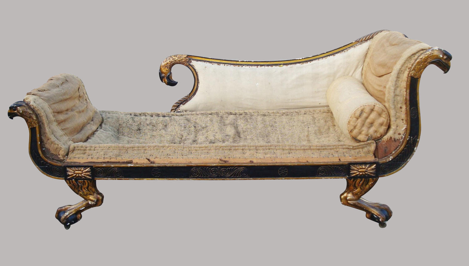 Regency carved black and giltwood daybed in the manner of George Smith