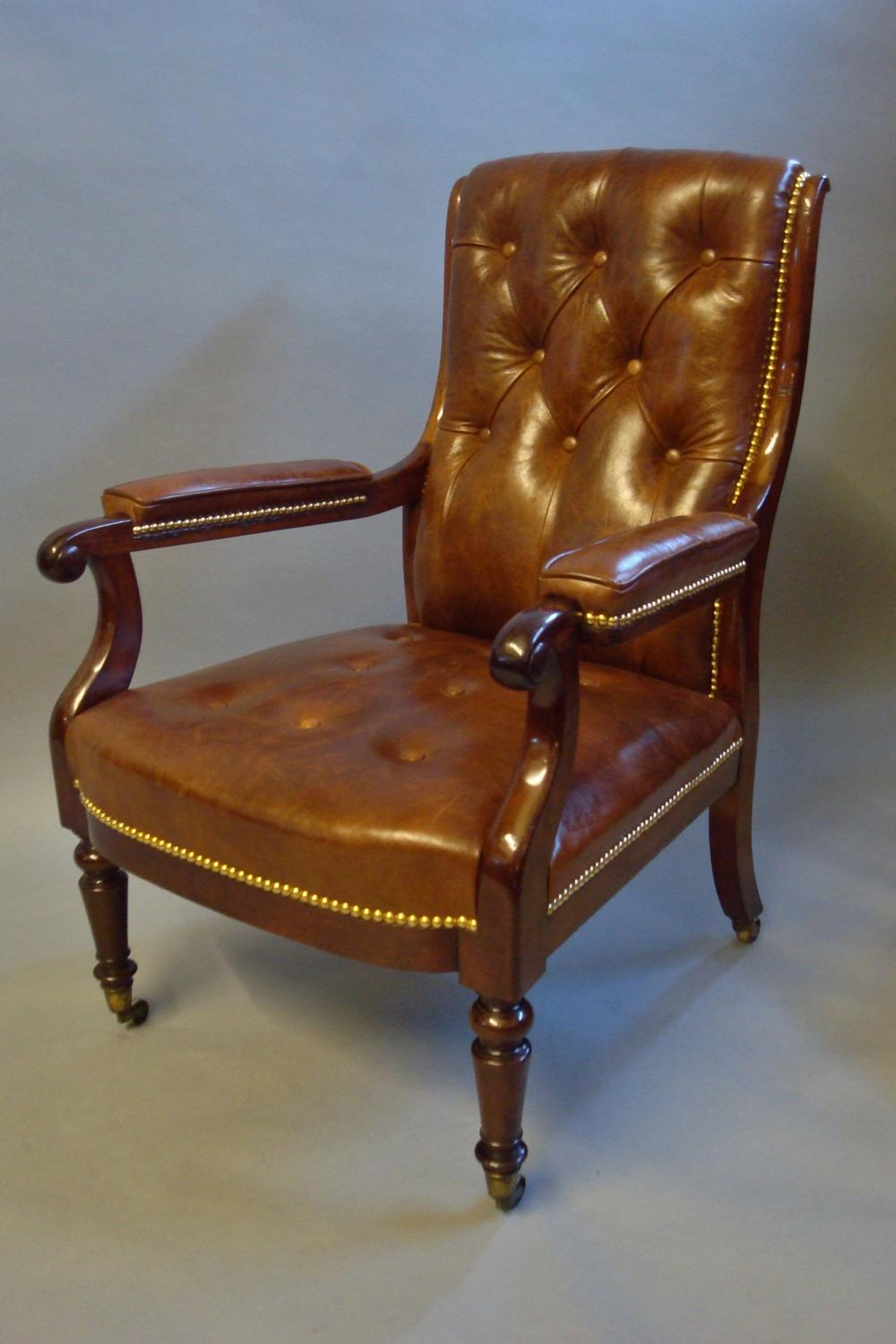 Regency mahogany and leather library open armchair