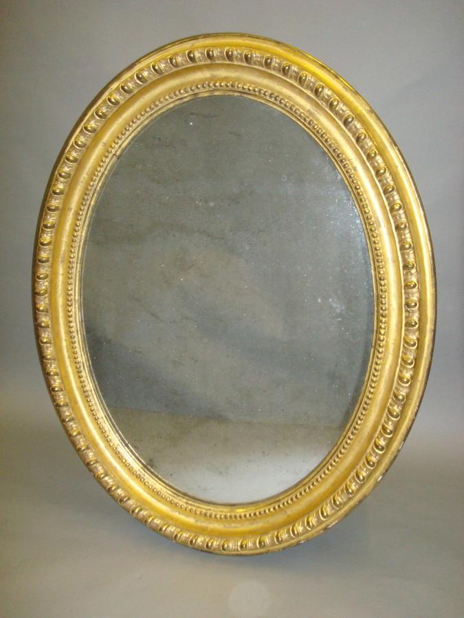 C19th giltwood oval wall mirror