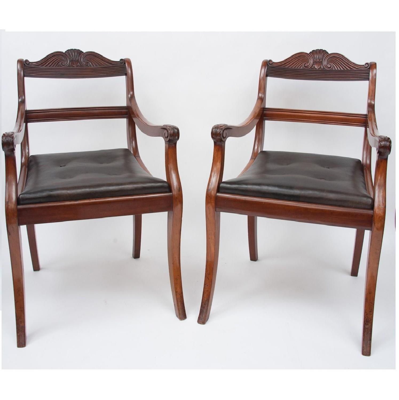 C19th pair of mahogany open armchairs