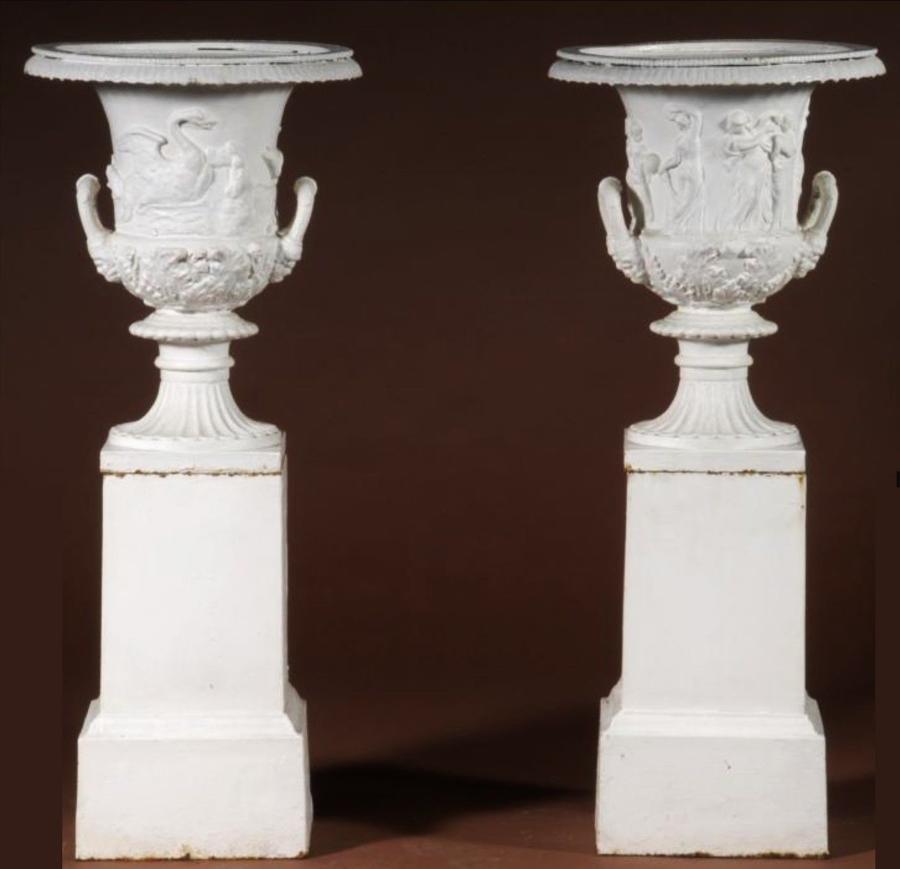 19th century pair of cast iron urns
