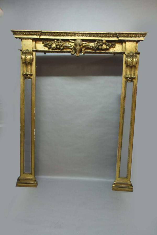 Regency carved giltwood Irish wall mirror