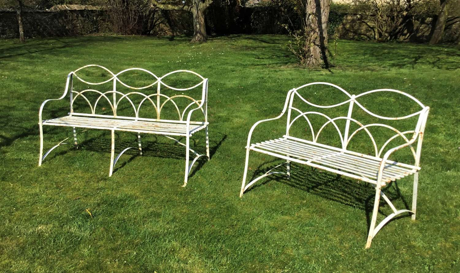 Early C20th pair of 2 & 3 seater wrought iron garden seats / benches