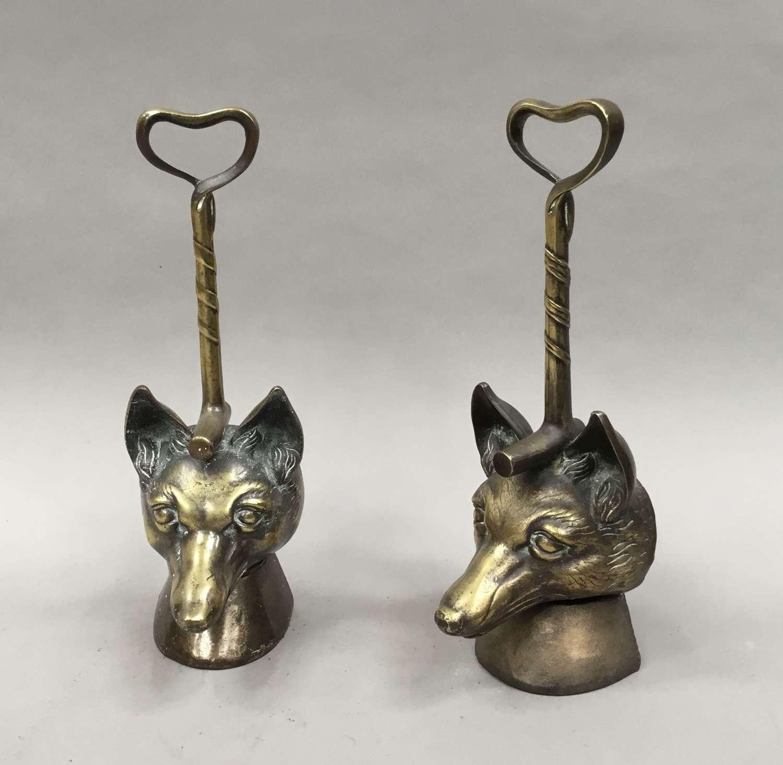 C19th matched pair of brass fox head doorstops / door porters