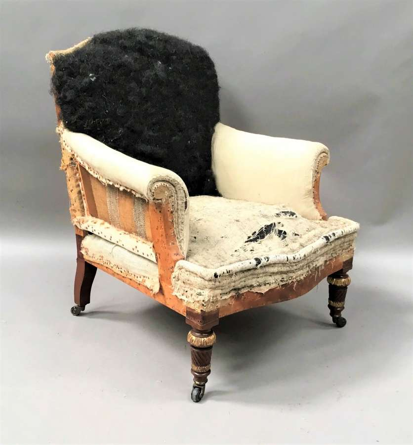 C19th mahogany upholstered library armchair