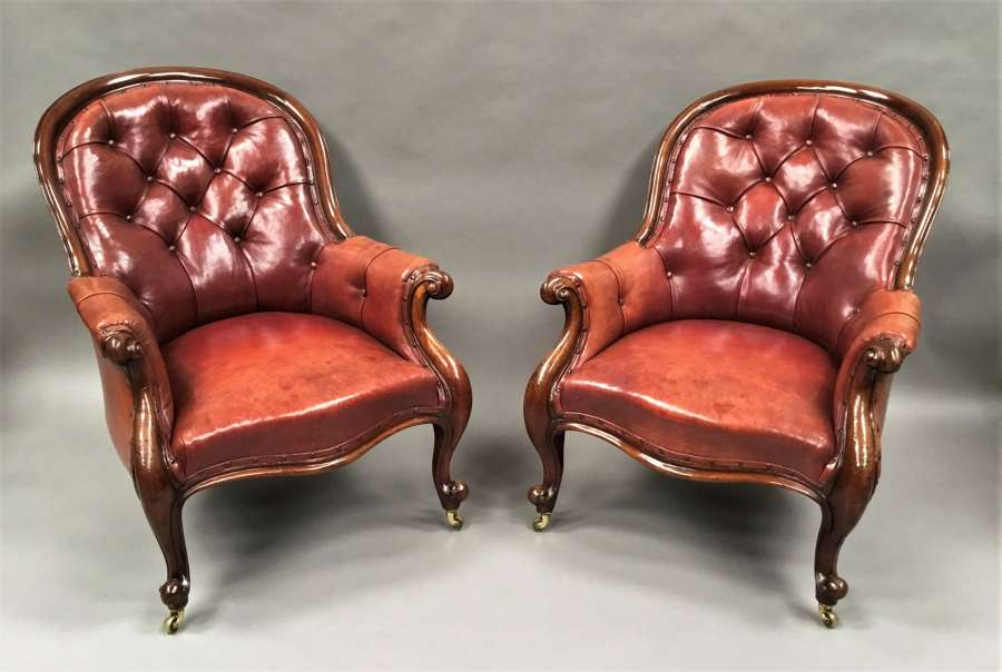 Mid C19th pair of mahogany and leather library armchairs