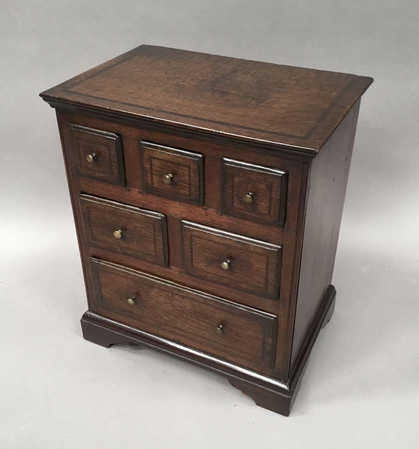 C18th miniature oak chest of drawers