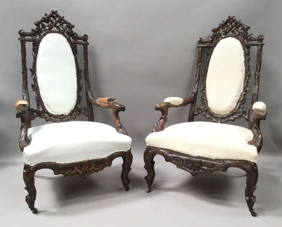 C19th pair of Black Forest open armchairs