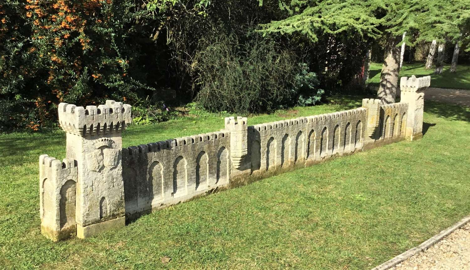 C18th carved stone 19ft scale replica of a castle / chateau wall