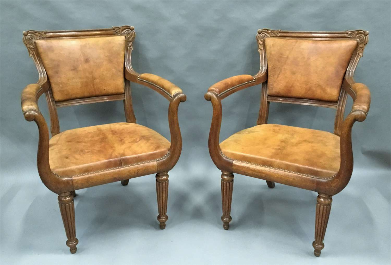 Regency pair of oak and leather library chairs
