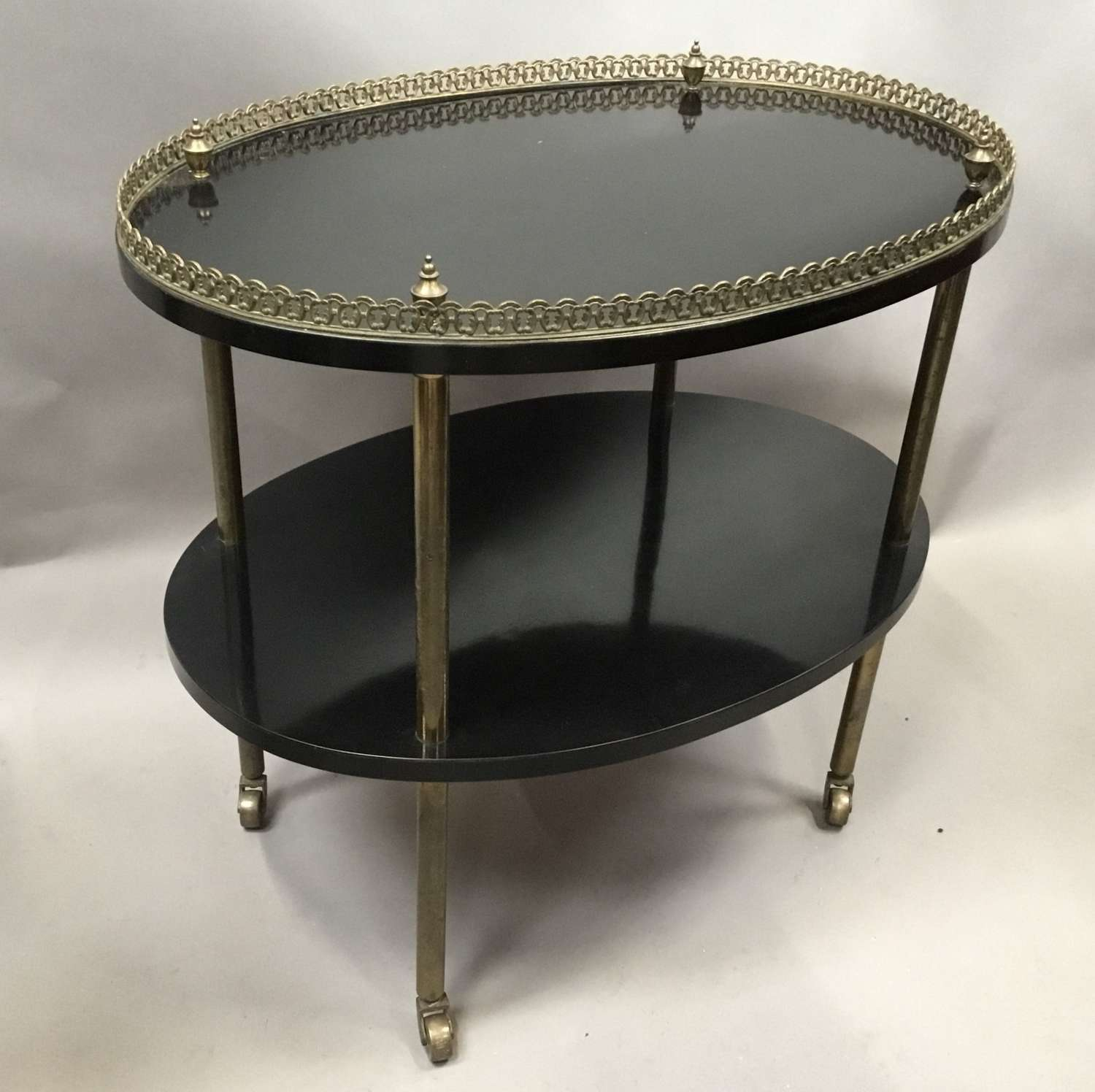 Early C20th ebonised and gilt brass etagere