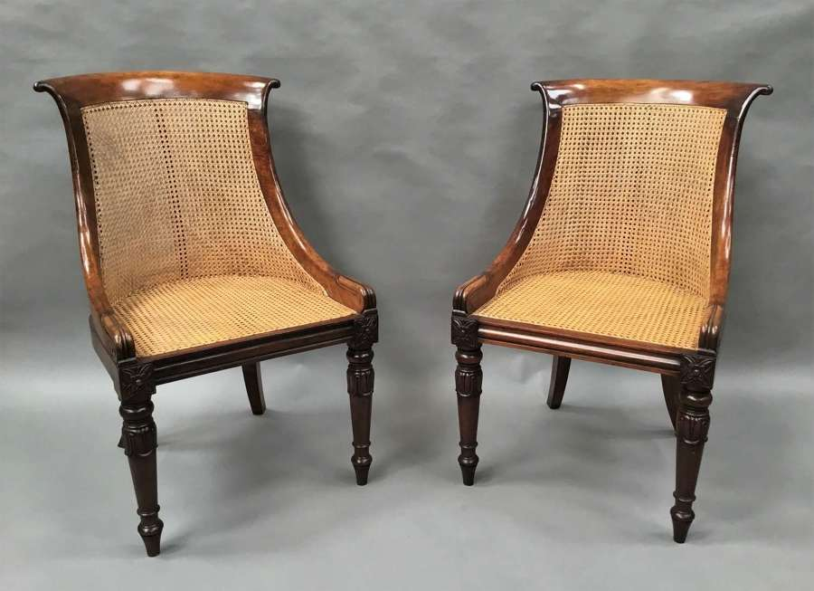 Regency pair of rosewood bergere library chairs attributed to Gillows