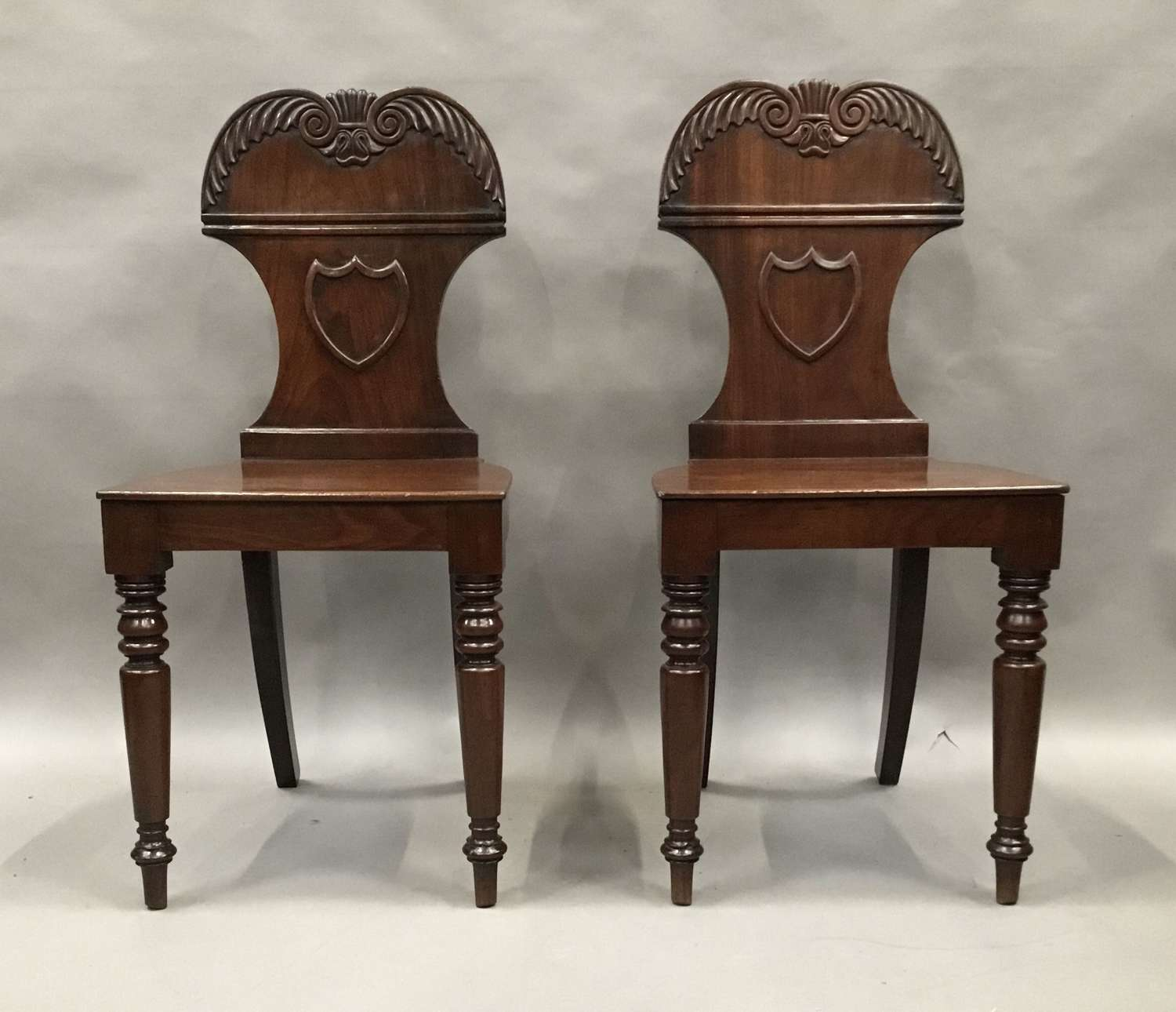 Regency pair of mahogany hall chairs