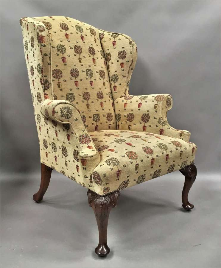 Good C19th carved mahogany upholstered wing / armchair