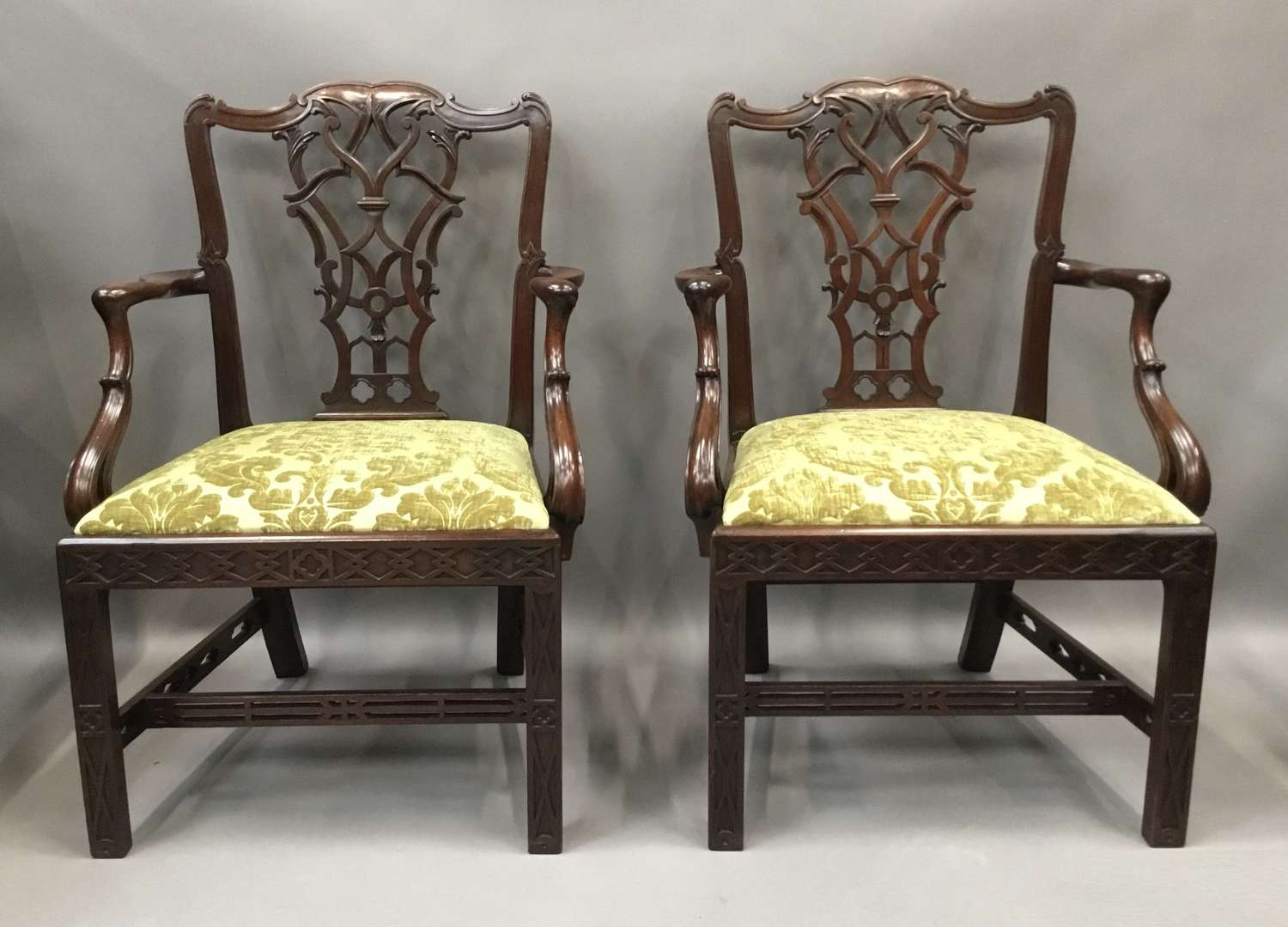 C19th pair of carved mahogany open armchairs in the Chippendale manner
