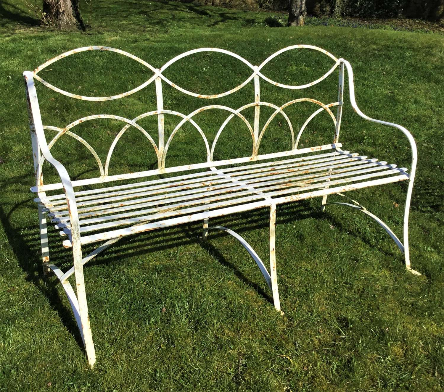 Early C20th triple seat wrought iron garden seat / bench